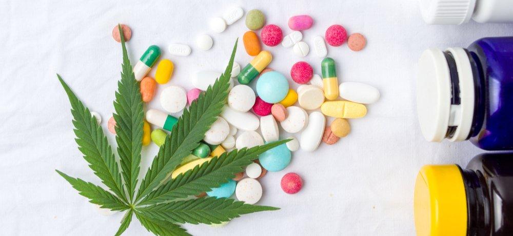 cannabis leaf with assorted prescription pills